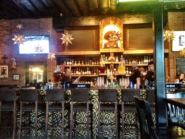 Pistolero's fully stocked bar and mosaic tile