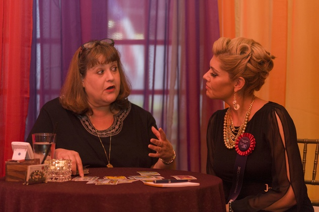 "45 Fortune Teller Joelle of Enlightened Spiritual Solutions gives a reading to Veronica ""Vee"" Mier at the HAA inaugural 40 under 40 party September 2014"