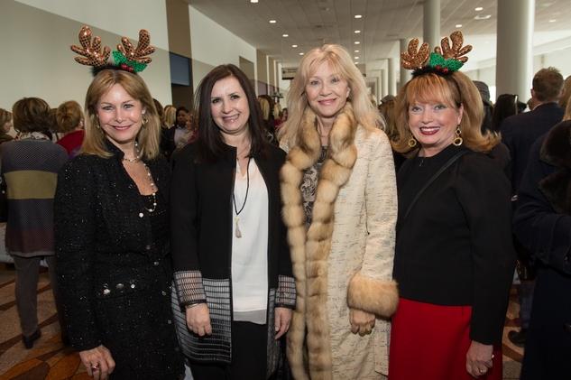 Cheryl Byington, from left, Sylvia Forsythe, Astrid Van Dyke and Karen Wildenstein at the Nutcracker Market Saks luncheon and fashion show November 2014