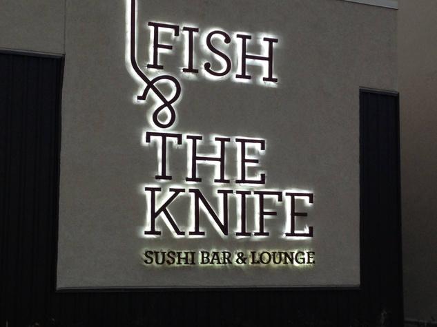 Fish & The Knife Sushi Bar & Lounge sign at night