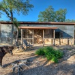Red Adair ranch house with pony