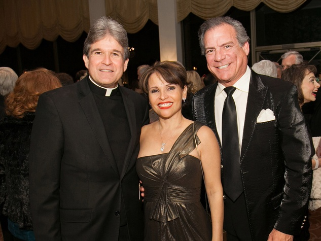 Frank Rossi, from left, with Lucia and Michael Cordua at the University of St. Thomas Mardi Gras March 2014