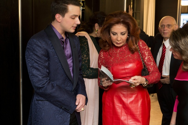 Jonathan Tinkle of Jonathan Blake and Nada Kirdar, viewing Jonathan's Look Book at trunk show in London