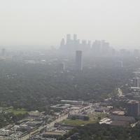 downtown Houston skyline smog haze pollution