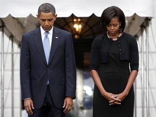 Barack Obama Michelle Obama praying heads down