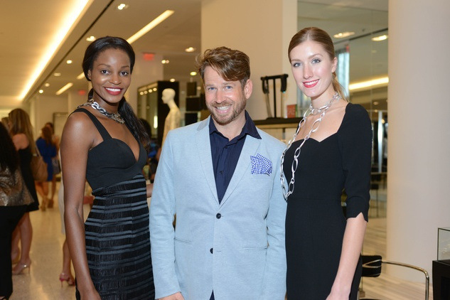 2 Models Cora Uwajeh, left, and Kristin Qualia with Jeff Shell at the WOW Summer Soiree August 2014