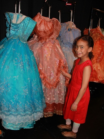 Cinderella at TUTS backstage with dresses