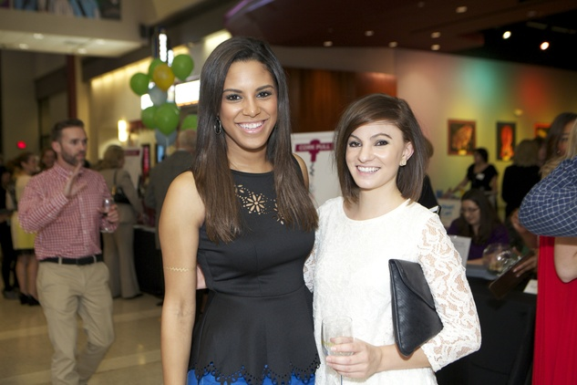 1253 Becca Green, left, and Courtney Lane at the Passport to the World wine and food event at The Health Museum October 2014