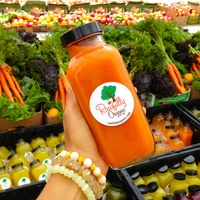 Rawfully Organic carrot juice and carrots and apples