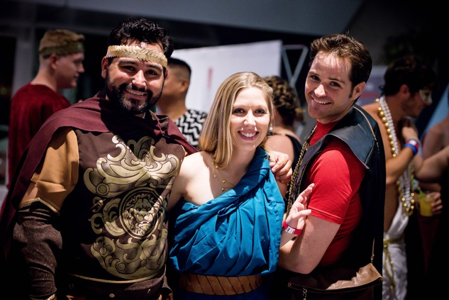 7 Daron Moreno, from left, with Jennifer and Steve McGrath at the Bering Omega Toga Party July 2014