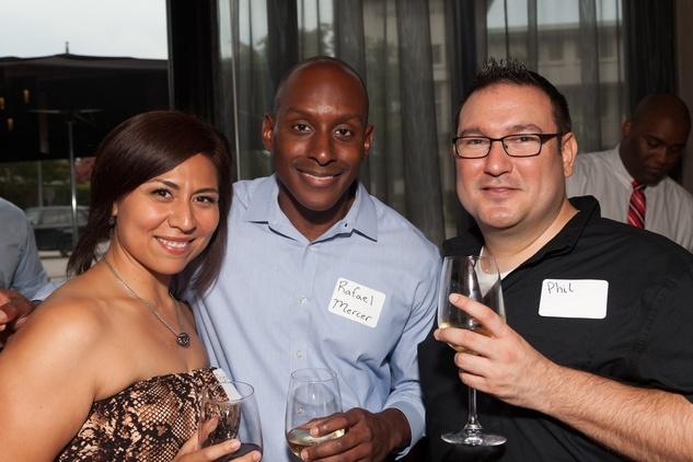 Patricia Ramirez, from left, Rafael Mercer and Phil Steuernagel at Casa de Esperanza Young Professionals party July 2014