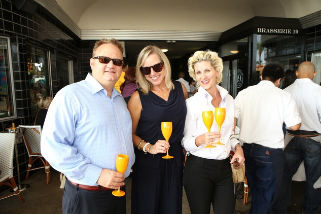Joe and Nancy Mathé, from left, with Paula Mott at Veuve Clicquot at Brasserie 19