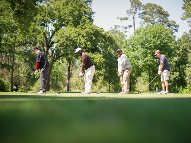8 Ronnie D. Meaux, from left, Carlos Rainer, Michael Harris and Mark Worden at the Children's Museum Spring Golf Classic April 2014