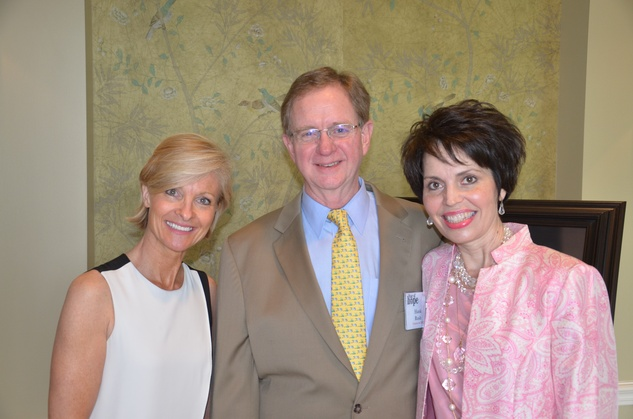 Dana Tyson, from left, with Hank and Elisabeth Rush at the Star of Hope Celebrity Fashion Show May 2014
