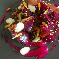 Oxheart, beets from Emile Street Garden with savory granola, wheatberries and bitter almond