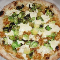 Pizza with Brussels sprouts and jam at Pieous in Austin