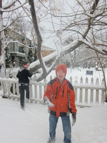 Two kids playing the snow in Texas