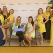 Kendra Scott in the middle and her Houston team with the Aflac Duck
