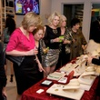 Guests viewing jewelry on sale for benefit at Theresa Roemer first charity closet party November 2014