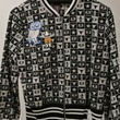 Vivenne Tam checkerboard jacket with Rice and Rodeo logos