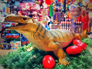 Toy Joy Downtown with toy lizard and silly putty