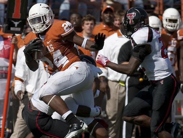 Texas running back Joe Bergeron breaks away from Texas Tech's Jarvis Phillips in Austin 2011