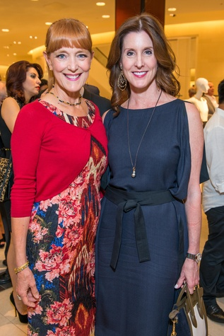 Gracie Cavnar, left, and Phoebe Tudor  at the Women of Distinction announcement party October 2014