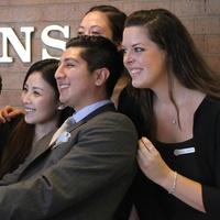 Four Seasons Hotel staff member demonstrate proper use of a Selfie Stick