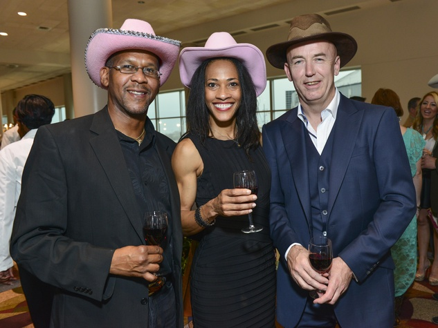 8 Carmelo Pieri, from left, Allyson Serrao and Thor Egeli at the RodeoHouston Wine Auction Dinner March 2014