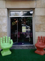 Toy joy downtown exterior with hand chairs