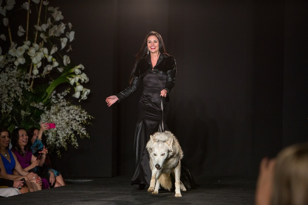 5 3750 A model with a wolf at the Jonathan Blake fashion party April 2014 Miss Texas 2013 Ali Nugent wearing mink and leather bolero over satin gown with wolf