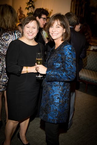 33 Mary Jones, left, and Elly Berman at the Valobra Pin Oak holiday party December 2014