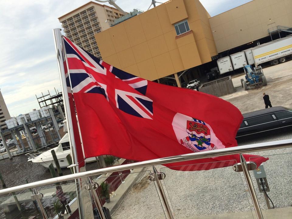 Tilman Fertitta yacht with flag in Biloxi May 2014