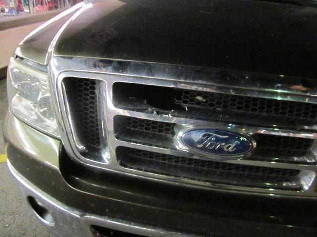 pickup truck hit by rock in grill near I-35 austin