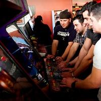 Guys playing games at Kung Fu Saloon