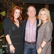 9 1633 Jennifer Stein, from left, Kirk Longmire and Kristy Phillips at the Jonathan Blake fashion party April 2014