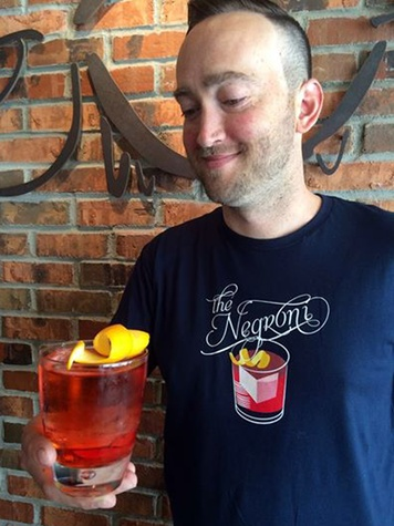News_Ellen Goodacre_Ravenous Pig Bartender holds Negroni_June 2014