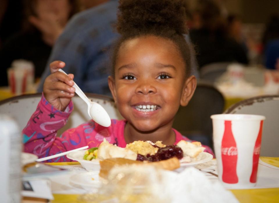 Austin Photo Set: News_Feast of Sharing_Nov 2011_kid eating