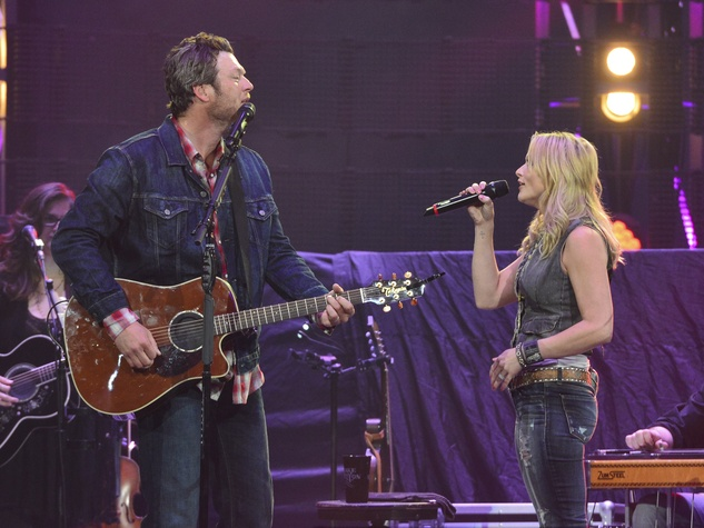 blake shelton disses levine springs big surprise at