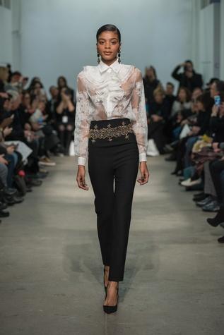 Rolando Santana jeweled pants and white blouse