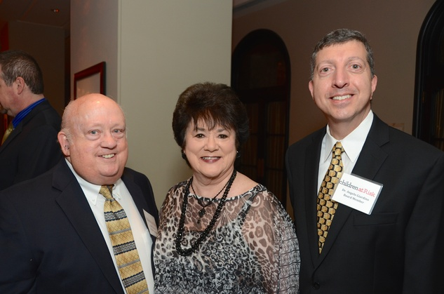 Bob and Janet Zincke, from left, with Dr. Angelo Giardino at the Children at Risk luncheon October 2014