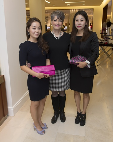 Guests holding Nancy Gonzalez creations at Nancy Gonzalez at Saks Fifth Avenue November 2014