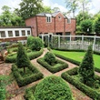 On the Market 7 Winston Woods July 2014 parteere garden with guest quarters over three-car garage