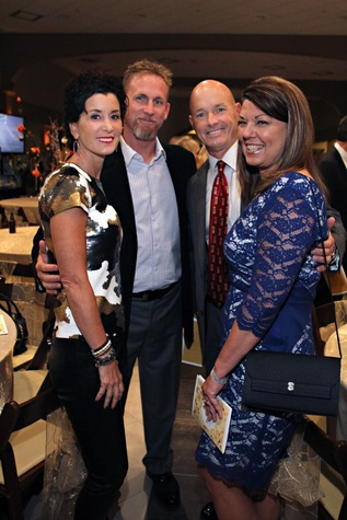 8 Kim and Woody Williams, from left, and Robert and Susan Thomas at the Mercedes-Benz of Sugar Land Cystic Fibrosis Event October 2014