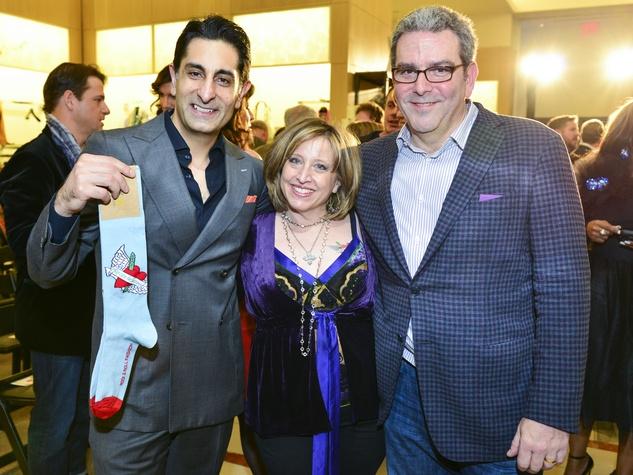 42 Vivek Nagrani, from left, with Karen and Murry Penner at Dress for Dinner February 2014