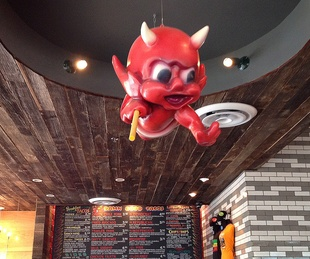Torchy's Tacos interior with red devil balloon