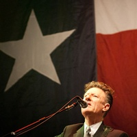 Austin Photo Set: News_Jon_Texas Heritage Songwriters_hall of fame_march 2012_lyle lovett texas flag