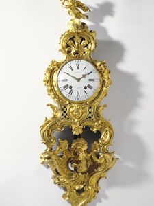 Clock movement by Jean-Romilly, French, 1714-1796 Case attributed to Charles Cressent, French, 1685-1768 Bracket by Jean-Joseph de Saint-Germain, French, 1719-1791 Clock on Bracket (Cartel sur une console) c. 1758 Gilt bronze, enameled metal; glass