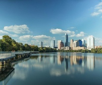 Lady Bird Lake boardwalk and Austin skyline