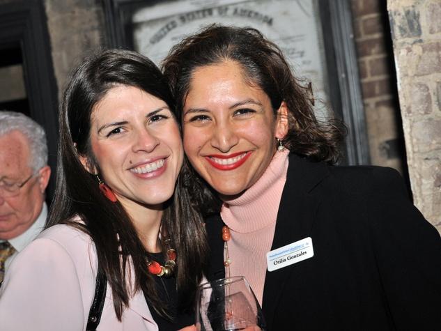 Lisa Uresti, left, and Otilia Gonzales at the Mayor's Hispanic Advisory Board Holiday Party December 2013